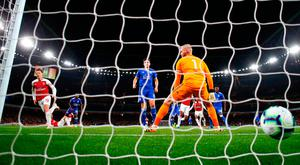 Leicester City's Kasper Schmeichel looks on as Mesut Ozil (left) scores Arsenal's first goal last night. Photo: Getty Images