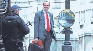 Bordering on madness: UK Brexit Minister Dominic Raab on Downing Street. Photo: DANIEL LEAL-OLIVAS/AFP/Getty Images