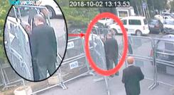 A still image taken from CCTV video and obtained by TRT World claims to show Saudi journalist Jamal Khashoggi, highlighted in a red circle by the source, as he stands with his fiancee Hatice Cengiz outside the Saudi Arabia's Consulate in Istanbul, Turkey October 2, 2018. Courtesy TRT World/Handout via Reuters