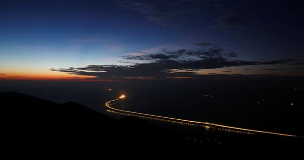 A sunset view of the Hong Kong-Zhuhai-Macau bridge off Lantau island in Hong Kong, China October 21, 2018, before its opening ceremony on October 23. Picture taken October 21, 2018. REUTERS/Bobby Yip