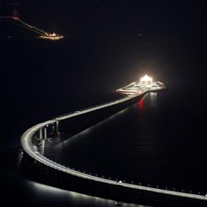 An evening view of the Hong Kong-Zhuhai-Macau bridge and its entrances to a cross sea tunnel, off Lantau island in Hong Kong, China October 21, 2018, before its opening ceremony on October 23, 2018. Picture taken October 21, 2018. REUTERS/Bobby Yip
