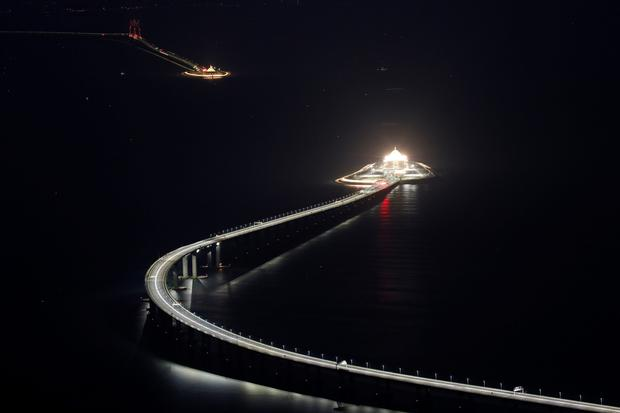 An evening view of the Hong Kong-Zhuhai-Macau bridge and its entrances to a cross sea tunnel off Lantau island in Hong Kong China