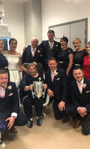 Aine and Paudie O'Dwyer bring the Liam McCarthy Cup to Paudie's mother Patricia in Limerick regional hospital on their wedding day | Image c/o Aine O'Reilly