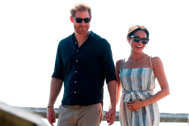 Prince Harry, Duke of Sussex and Meghan, Duchess of Sussex walking along Kingfisher bay walk about on October 22, 2018 in Fraser Island, Australia