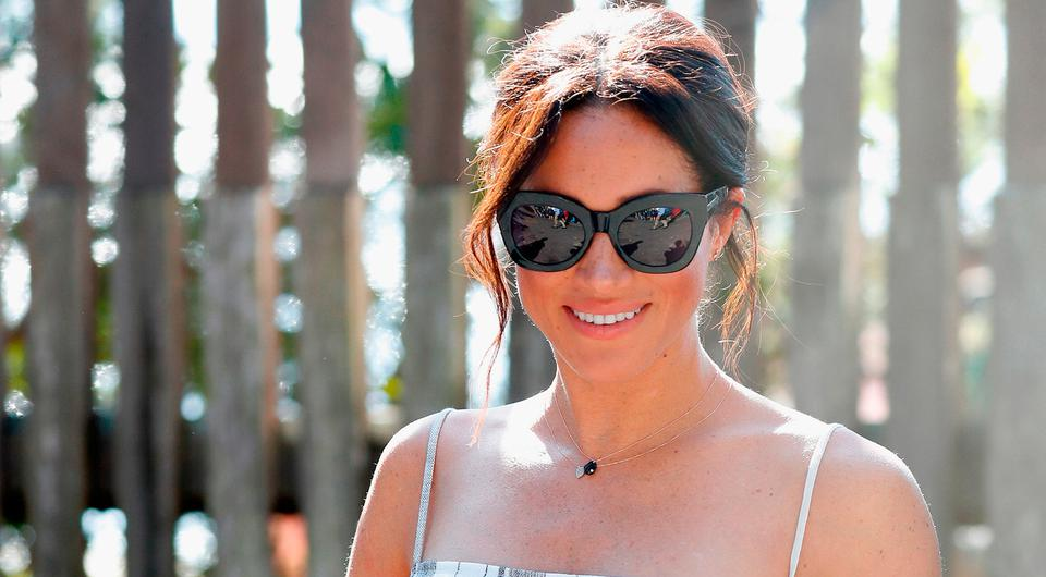 Meghan, Duchess of Sussex walks along the picturesque Kingfisher Bay Jetty on October 22, 2018 in Fraser Island, Australia