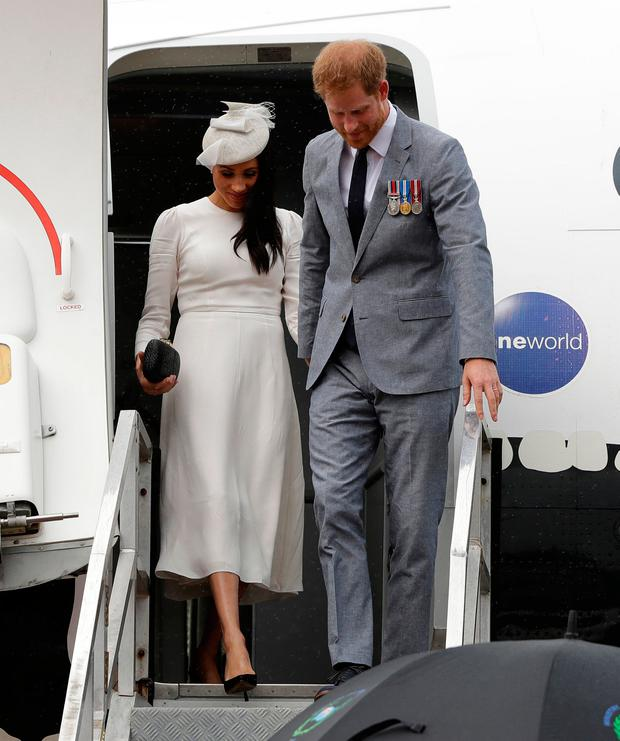 Prince Harry, Duke of Sussex and Meghan, Duchess of Sussex disembark from their plane on their arrival in Suva on October 23, 2018 in Suva, Fiji