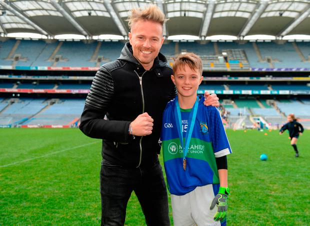 23 October 2018; Westlife member Nicky Byrne with his son Rocco Byrne from St. Oliver Plunkett NS, Malahide, Co Dublin, during day 2 of the Allianz Cumann na mBunscol Finals at Croke Park in Dublin. Photo by Harry Murphy/Sportsfile