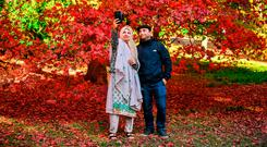 Colourful: People take selfies in front of autumn leaves at the National Arboretum near Cheltenham in Gloucestershire. Photo: Ben Birchall/PA