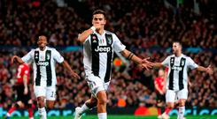 Juventus' Paulo Dybala celebrates scoring his side's first goal of the game during the UEFA Champions League match at Old Trafford, Manchester. Martin Rickett/PA Wire