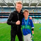 Father and son: Nicky Byrne and son Rocco at Croke Park for the Allianz Cumann na mBunscol Finals – and where Nicky will perform next July. Photo: Harry Murphy/Sportsfile