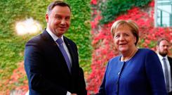 Talks: German Chancellor Angela Merkel welcomes Poland's President Andrzej Duda at the chancellery in Berlin, Germany. Photo: Reuters