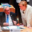Brexit talks: German Chancellor Angela Merkel speaks with European Commission President Jean-Claude Juncker during a EU summit in Brussels. Image: AP