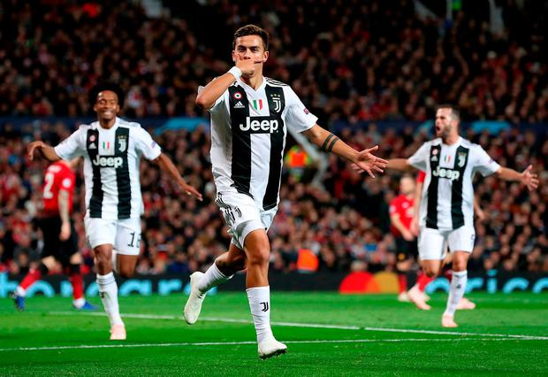 Juventus's Paulo Dybala celebrates after scoring the only goal of the game. Photo: Martin Rickett/PA Wire