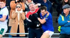 Colm Geaney (left) lashes out at Dara Moynihan of East Kerry. Photo: Domnick Walsh