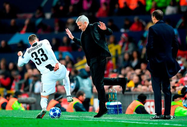 Manchester United boss Jose Mourinho jumps to avoid Federico Bernardeschi of Juventus during last night's Champions League clash. Photo: Michael Regan/Getty Images