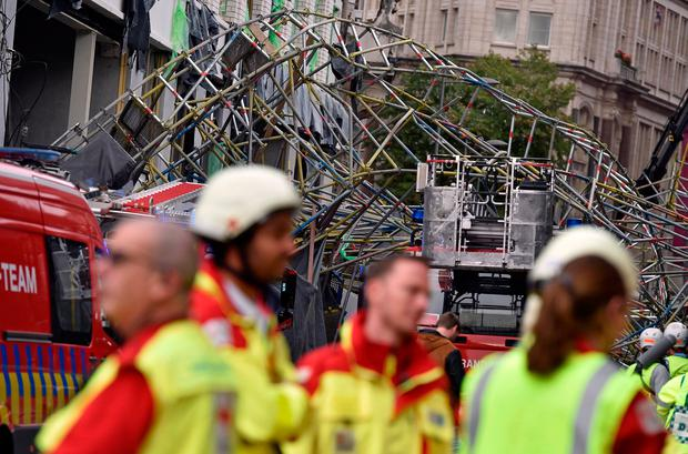 Rescue personnel is seen at the scene of a scaffolding collapse in Antwerp, Belgium October 24, 2018. REUTERS/Eric Vidal