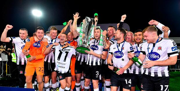 Dundalk players celebrate with the trophy