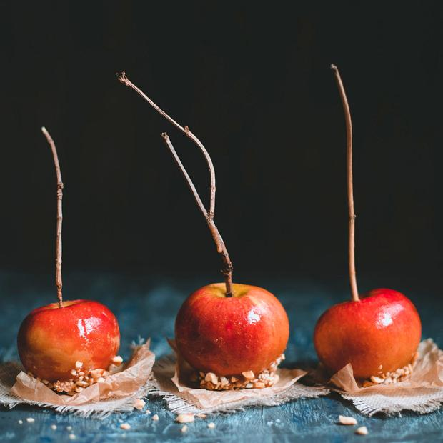 Old fashioned caramel apples with brunch sticks and nuts