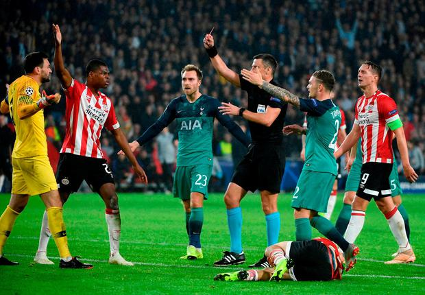 Tottenham Hotspur's French goalkeeper Hugo Lloris (L) reacts as he receives a red card during the UEFA Champions League Group B football match between PSV Eindhoven and Tottenham at Philips Stadium in Eindhoven