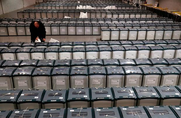Election warehouse manager Michael Leonard checks the seals on ballot boxes in Dublin in preparation for delivery to polling stations as the country is set to go to the polls on Friday to vote for the presidency and the referendum on blasphemy law. Photo: Brian Lawless/PA Wire