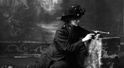 Countess Constance Markievicz in uniform poses with a gun. Picture: National Gallery of Ireland