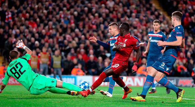 Sadio Mane hits the rebound from his missed penalty wide. Photo: Martin Rickett/PA Wire