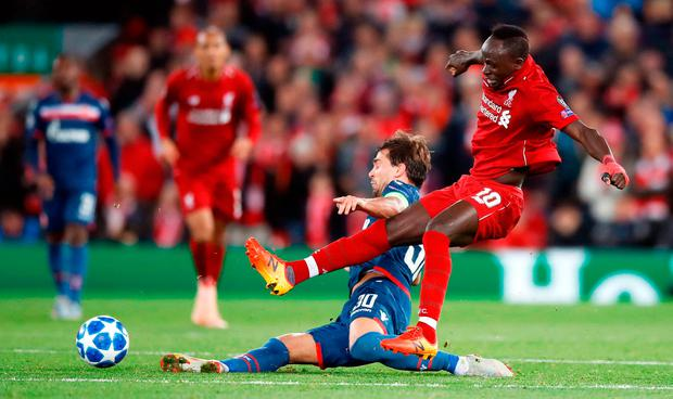 Filip Stojkovic gets to the ball ahead of Liverpool's Sadio Mane. Photo: Martin Rickett/PA Wire
