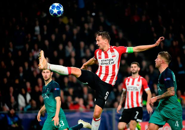 PSV Eindhoven's Luuk De Jong leaps in the air to control the ball. Photo: JOHN THYS/AFP/Getty Images