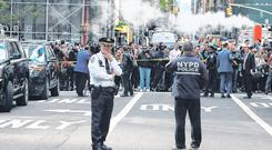 Members of the NYPD in Manhattan after a suspicious package was found inside the CNN Headquarters in New York. Photo: Kevin Coombs/Reuters