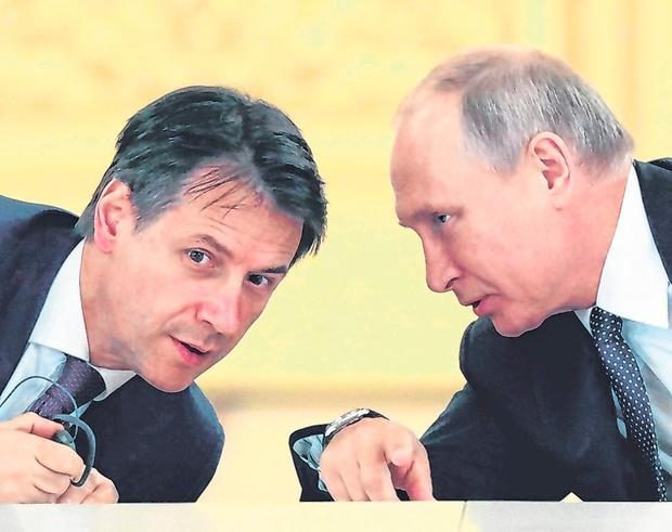 Russian President Vladimir Putin speaks with Italian Prime Minister Giuseppe Conte at the Kremlin in Moscow. Photo: Reuters