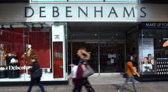 Debenhams is closing stores after posting the biggest loss in its history (Nick Ansell/PA)