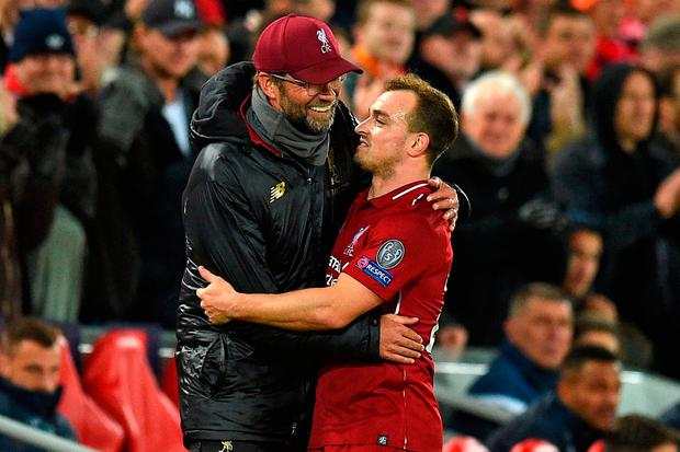 Jurgen Klopp chats with Liverpool's Xherdan Shaqiri as he's substituted