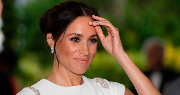 Pregnant Duchess Meghan Markle's Growing Baby Bump Visible During Christmas Carol Event
