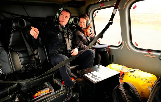 Marian Roarty presiding officer and Garda Eamonn McGinley arrive by Irish Air Corp helicopter on Tory Island, off the coast of County Donegal, with a ballot box for the Irish presidential election and referendum on blasphemy. Niall Carson/PA Wire