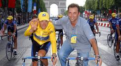 Lance Armstrong and Johan Bruyneel celebrate after the 2002 Tour ( AFP/Getty Images )
