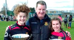 Ennis RFC president Richard Murphy with Emily Murphy (U-15 girls' captain) and Grace Colleran (U-18 women's captain)