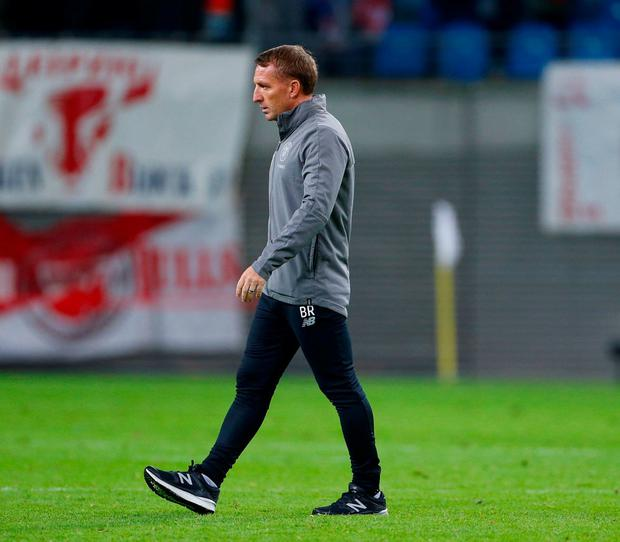 Oh Bhoys: A dejected Brendan Rodgers is all alone with his thoughts as he leaves the pitch at the Red Bull Arena after Celtic's defeat by Leipzig. Photo: Hannibal Hanschke/Reuters