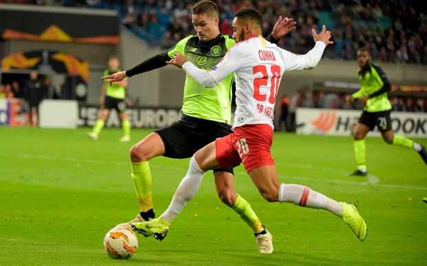 Leipzig's Matheus Cunha, right, and Celtic's Mikael Lustig. Photo: Jens Meyer/AP Photo
