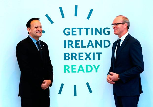 Preparation: Taoiseach Leo Varadkar and Tánaiste Simon Coveney at the Brexit event. Photo: Brian Lawless/PA