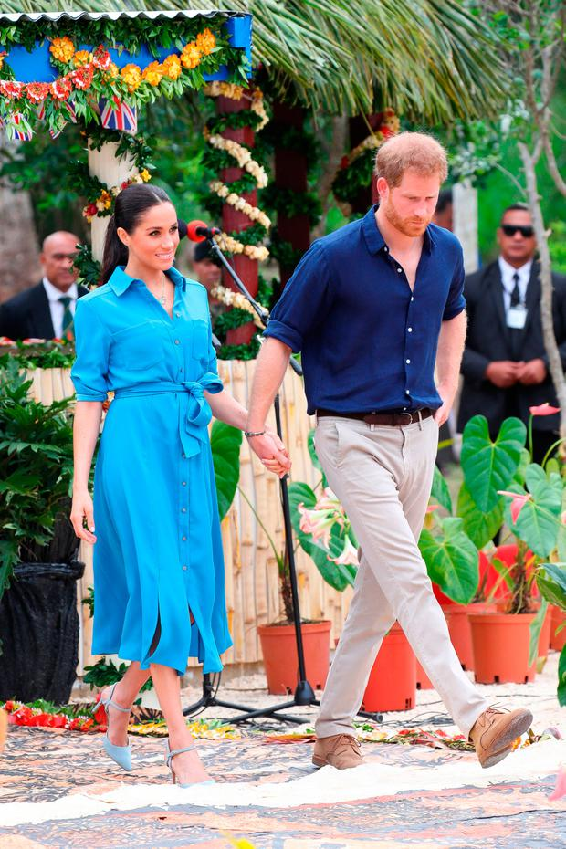 Prince Harry, Duke of Sussex and Meghan, Duchess of Sussex walking over to participate in the Unveiling of The Queen's Commonwealth Canopy at Tupou College on October 26, 2018 in Nuku'alofa, Tonga