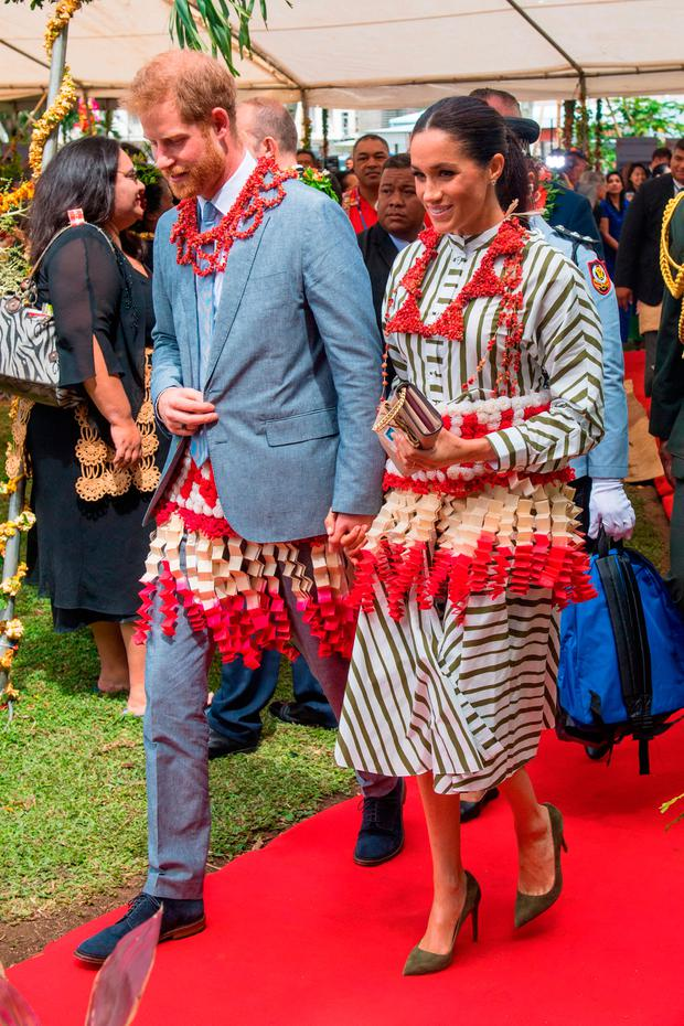 Prince Harry, Duke of Sussex and Meghan, Duchess of Sussex visit an exhibition of Tongan handicrafts, mats and tapa cloths at the Fa'onelua Convention Centre on October 26, 2018 in Nuku'alofa, Tonga