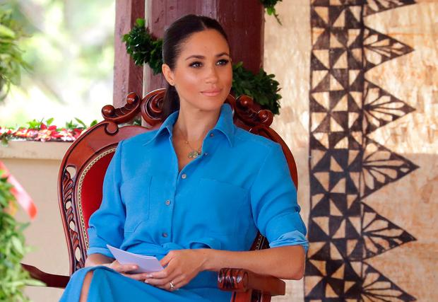 Meghan, Duchess of Sussex talks with students during a visit to Tupou College in Tonga on October 26, 2018