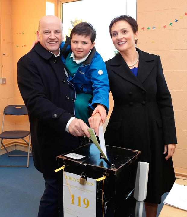 Sean Gallagher casts his vote in the presidential election with his wife Trish and son, Bobby, 5, at the Charlesland Sports and Recreation centre in Greystones. Pic credit; Damien Eagers / INM