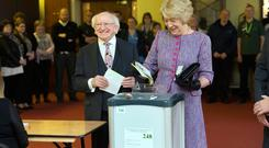 President Michael D Higgins casts his vote with his wife Sabina for the Presidential Election at St Mary's Hospital, Phoenix Park this morning. Photo: Tony Gavin