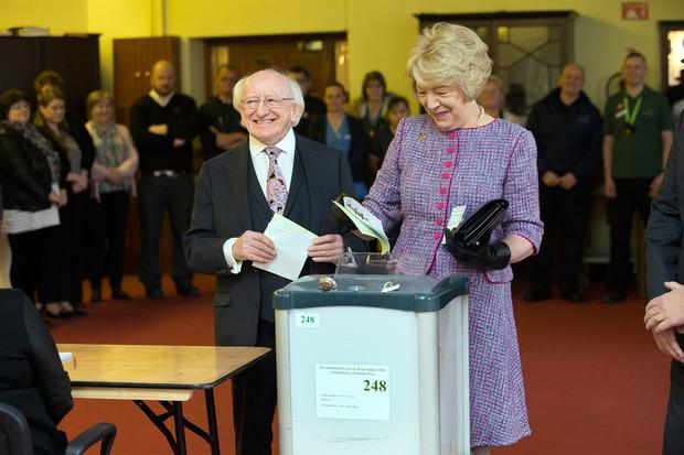 President Michael D Higgins votes with his wife Sabina for presidential election at St Mary's Hospital, Phoenix Park this morning. Photo: Tony Gavin