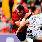 Peter O'Mahony of Munster in action against Jake Polledri, left, and Callum Braley of Gloucester last week