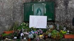 BURIAL GROUND: A sign which reads Dignity left at the grotto in the Tuam Mother and babies site. Photo: Andy Newman