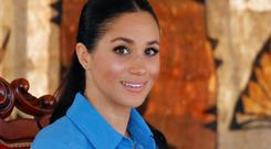 Fit of giggles: Meghan Markle at Tupou College in Tonga. Picture: Reuters