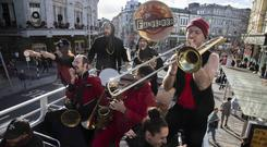 Left: Heavy funk brass band Les Fanflures transformed the streets of Cork city yesterday with vibrant jazz sounds. Picture: Clare Keogh