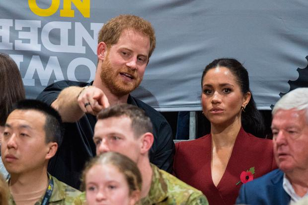 The Duke and Duchess of Sussex watch the Invictus Games 2018 wheelchair basketball final in Sydney. Photo: Dominic Lipinski/PA